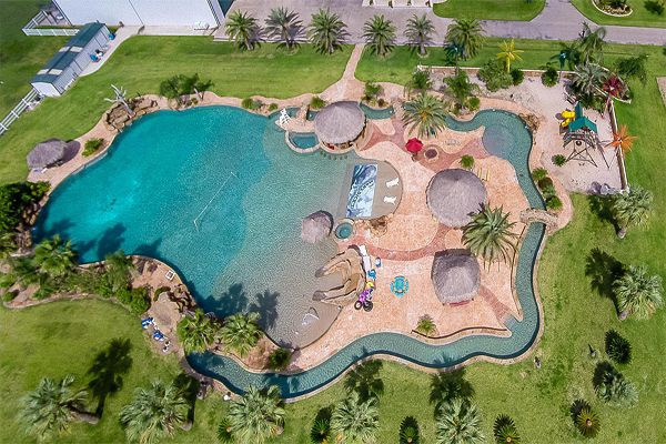 "Now this is a backyard lazy river.... it's actually considered the ""World's Largest Residential Lazy River."" The only pump up for the job is Riverflow Pumps!"