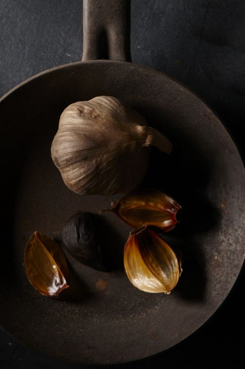 Black garlic is made by treating regular garlic with heat and humidity for about a month. Because of the gentle aging process, its health benefits are maintained, but its flavor is much more palatable than regular garlic. This version is sweet with hints of balsamic, tamarind and molasses. Read more: http://www.askmen.com/sports/galleries/top-50-superfoods-4.html#ixzz2rhmdBJbZ