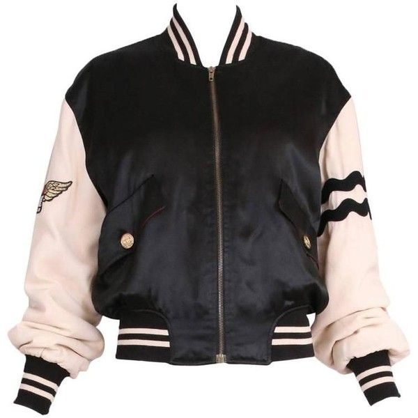 """Preowned Vintage Moschino Cheap & Chic """"4 Your Eyes Only"""" Varsity... (3.940 BRL) ❤ liked on Polyvore featuring outerwear, jackets, tops, coats, coats & jackets, black, 80s jackets, varsity bomber jacket, patch jacket and letterman jacket"""