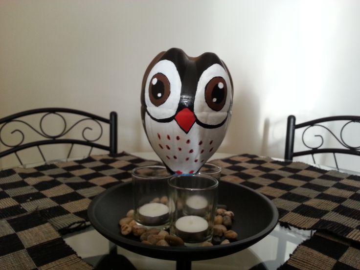 Owl with coke bottle