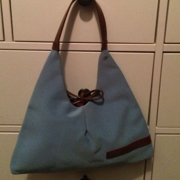 Matt and nat Montreal shoulder bag - flash sale This is a power blue Matt and Nat Montreal shoulder handbag with brown leather accents. It's shape is super unique and will add a creative twist to your outfit. The interior is clean and the bag is very gently used. This bag comes from a smoke and pet free home. You will love this bag!  matt and nat Bags Shoulder Bags