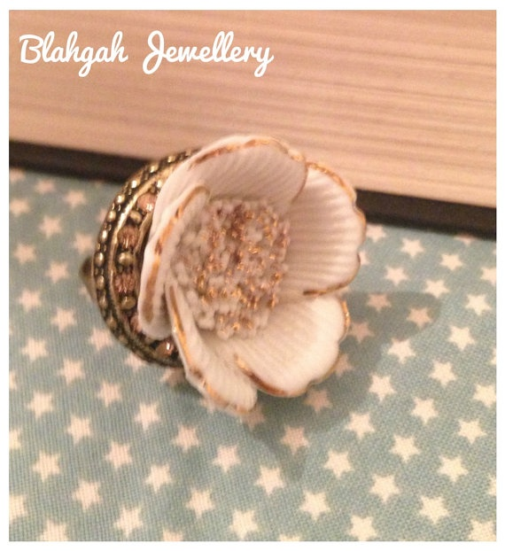 Ceramic flower ring by BlahgahJewellery on Etsy, £6.00