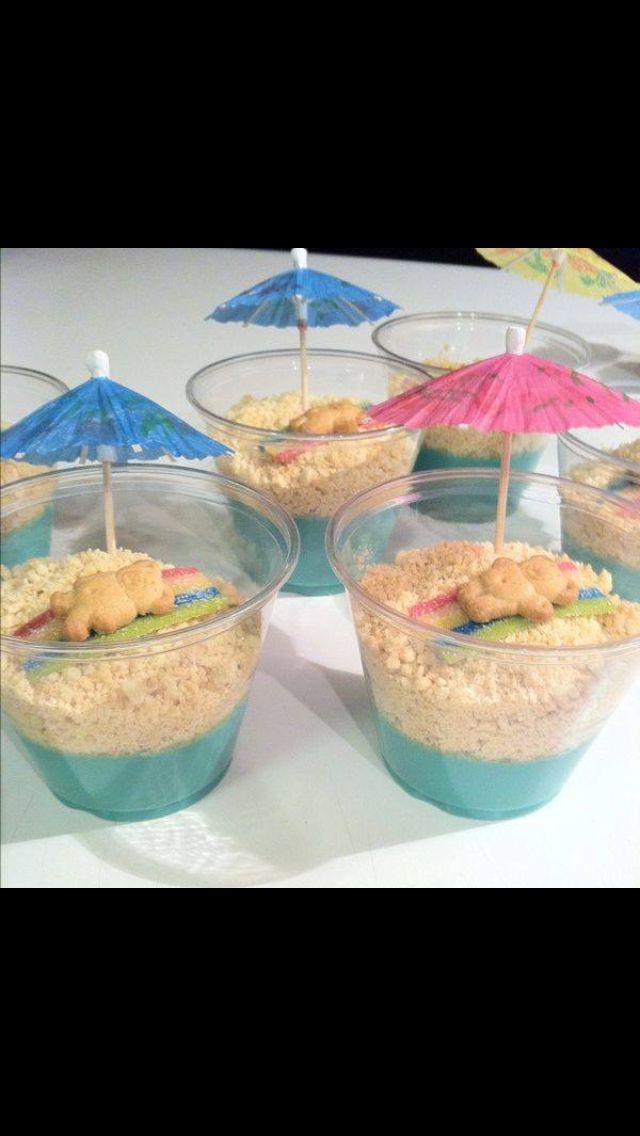 Blue vanilla pudding, gram crackers, air head strips, teddy bear cookies, and a umbrella