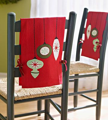 Casual Dining Christmas Style  Cute Christmas towels cheer up casual dining chairs for the holiday season. Simply stitch the short ends of two towels together, and add slits to thread ribbon through for ties. Drape the stitched towel over a chair, thread the ribbons through the slits, and tie the ribbon into bows.-could do this with any season