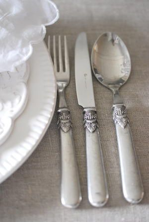 Antique cutlery with grey and white table linens gives a lovely vintage yet sophisticated touch to table settings x