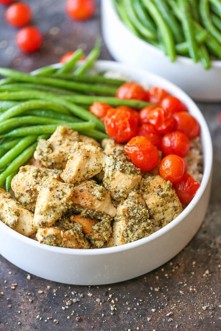 Chicken Pesto Bowls - Healthy pesto chicken bowls served with brown rice, green beans and roasted tomatoes! Easy peasy and can be prepped ahead of time!