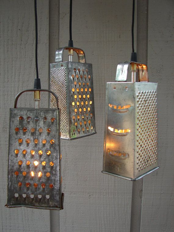 String some lights through old cheese graters for these cool hanging lamps.