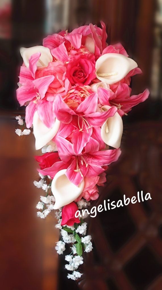 WHITE CASCADING BRIDAL BOUQUETS WITH A TOUCH OF PINK