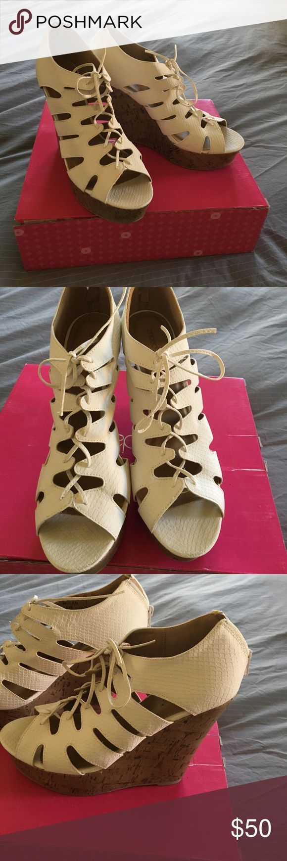 Shoedazzle White Cork Wedges Only worn once, they are a little too small for me. These are surprisingly easy to walk in and a such a cute caged style. The white part is a soft fake snake skin like material. ShoeDazzle Shoes Wedges