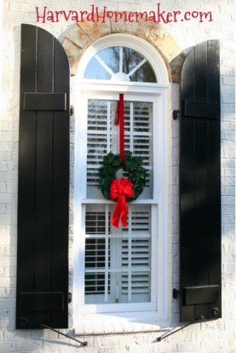 Simple Way to Hang Wreaths on Windows.  Use the same ribbons and wreaths year after year.  So easy and the house looks festive day and night!  #holiday decorating