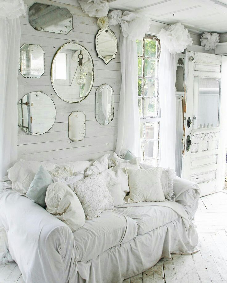 Great look with the mirrors surrounded by shabby chic!