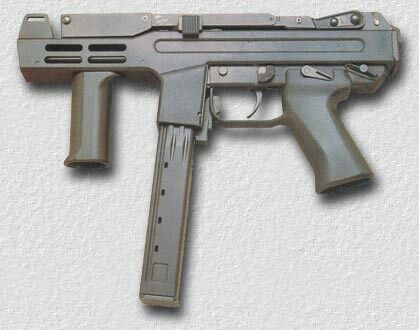 The Italian 9mm Spectre sub-machine gun with a top folding stock and specially designed 50rnd magazine.