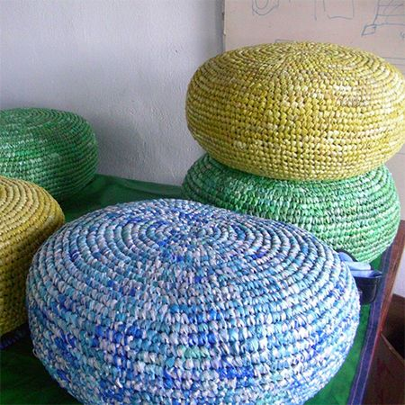 Made from recycled plastic shopping bags these pouffs can be used indoors or outdoors. Pack the inside with plastic bags if you want to use them outdoors, or stuff with old clothes, bedlinen and towels for indoors. They are perfect for kid's bedrooms, a family room or by the pool. Use an extra-large crochet hook to make your own. http://www.easydiy.co.za/index.php/make/189-crafty-ways-to-recycle-plastic-bottles-and-bags