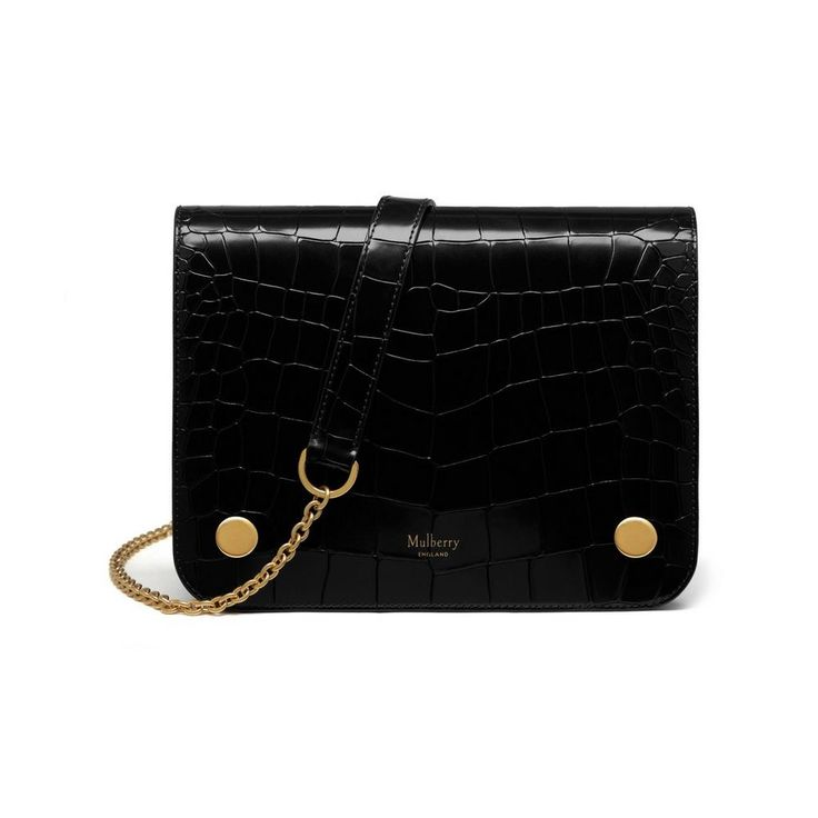 Introducing the Clifton in black polished embossed croc leather, a new compact, cross body style bag from our Autumn '16 Collection. The bag features three zipped internal pockets providing ample room for essentials and the chain strap can be adjusted from cross body to shoulder bag for additional versatility.