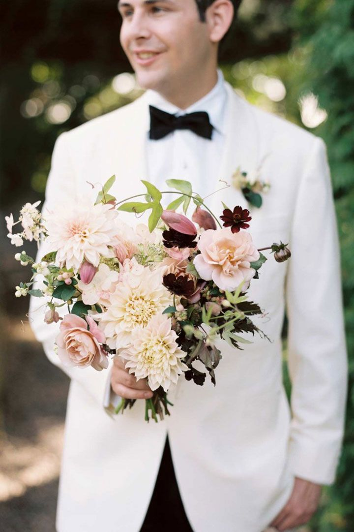 Pretty blush and cream bouquet of dahlias, roses and cosmos by Saipua.