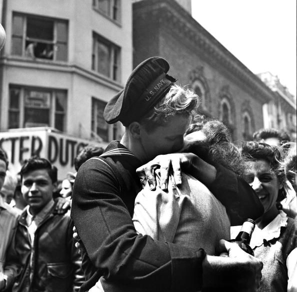 A kiss in Times Square displays the mood of the world on V-E Day (or 'Victory in Europe' Day), signalling the end of hostilities in the European theater in World War II, on May 8, 1945, in New York, New York. (Photo by Michael Ochs Archives/Getty Images)