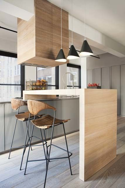 Tour an Airy New York City Loft That Mixes Old and New Designed by P&T Interiors Posted July 23, 2014 in Top Designers At Work by Dering Hall The apartment features iconic furniture pieces like the Arthur Umanoff barstools as well as the Paul McCobb desk, coffee table and night stands