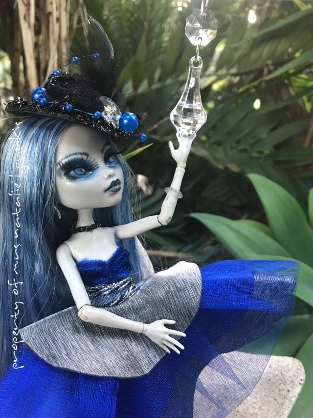 Monster high ooak   Aurora is my 21st custom doll! She was a Black and white skull shores frankie in her past life but been recreated by myself using Hair from Monster high and ever after high custom reroots on facebook ( CustomDollHairAU on etsy)  Dress and hat is from TheLovelyDirector on etsy , faceup is by myself using water colour pencils , MSC , soft pastals , acrylic paint , and she has real eyelashes, shoes where a ghoulias that i painted a little darker and added grey laces !