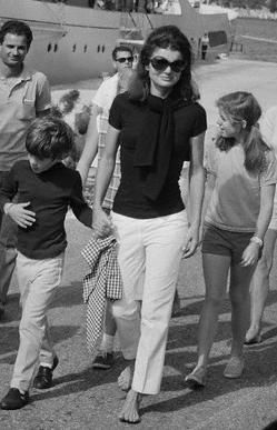 Jackie Kennedy Onassis with her children, John, Jr. and Caroline on the Onassis private island of Skorpios, Greece in 1968.