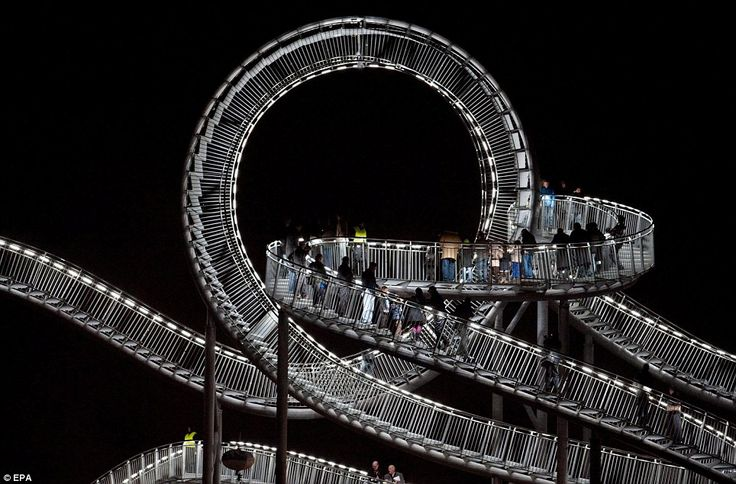 Tiger and Turtle Magic Mountain. Photo taken at night, visitors can walk on various parts of the installation