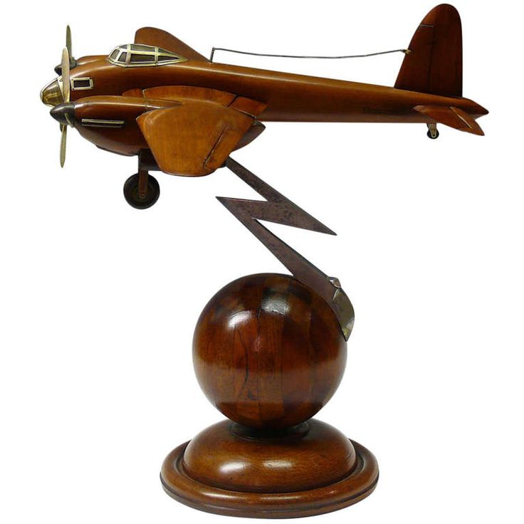 Wooden model of a De Havilland Mosquito with retracting landing gear and moveable ailerons and tail plane. On Art Deco style base.  UK c. 1945.