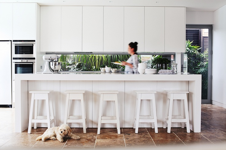 Amazing kitchen with glass splashback works brilliantly to show off the greenery in the garden outside. This coastal Sydney home is so serene and beautiful. As seen in Adore Home magazine's Apr/May 2012 edition. www.adoremagazine.com