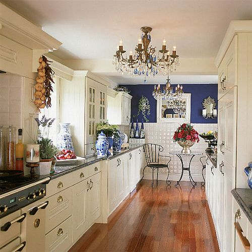 Fresh and clean blue and white kitchen.  The chandelier is great!