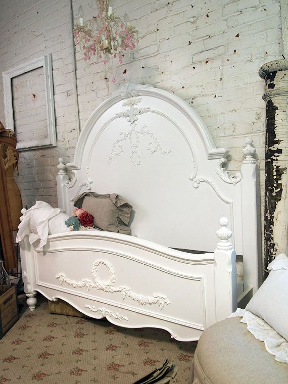 A dream come true starts with this beautiful Romance Collection bed. The headboard rises in a rounded crest with floral and vining carvings accenting the top and panel inset. Posts with turned finials are a finishing touch complemented by the scalloped foot.    Can be painted in any color or finish or your choice.    SHOWN IN Queen:    TWIN: $995  Headboard: 42 in. L x 4 in. W x 55 in. H (58 lbs.)  Footboard: 42 in. L x 3 in. W x 51 in. H (34 lbs.)  Rails: 76 in. L x 1 in. W x 5 in. H (24…