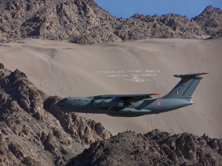 An Indian Air Force plane takes off in the mountainous Kashmir region from the town of Leh. All flights must pass through a narrow ravine shortly after take-off, or before landing, making for a spectacular departure/arrival. On side of this ravine is the Indian Air Force motto chalked out for all to witness.