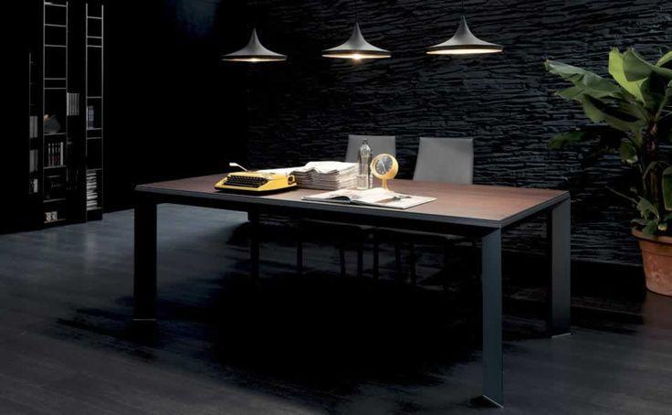 METRO', design: Toshiyuki Yoshino/Studio Ozeta - Aluminum frame dining table, telescopic mechanism extending frame, aluminum and wooden panel top and extension. www.ozio.com