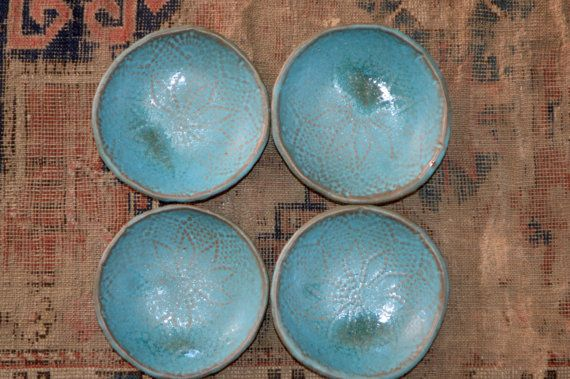 This is a unique SET of 4 bowls. The glaze is a turquoise color with a matte finish.  Each one is unique because they were hand molded. They are modern looking and a chic beach style. They measure aprox. 6 and are food safe. They make a great gift as well. They are all signed in the back. They went twice in the kiln, first to bisque fire and then high fired. They are dishwasher safe, but I do recommend to hand wash for durability. Please allow 4-6 week for shipping!  Eating from a Handmade…