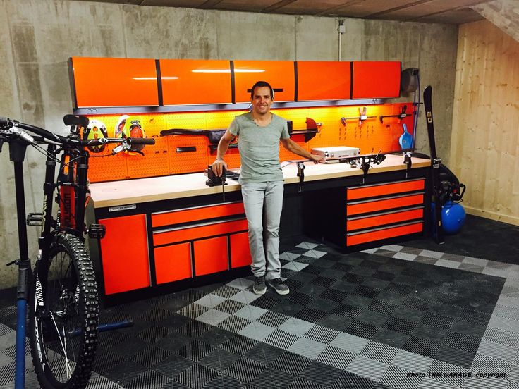Our friends at TRM Garage in France utilize Wall Control Metal Pegboard Products for some pretty cool projects across the pond! Here is Benoit Treluyer, the official driver of Audi Factory in Le Mans Series, in front of his new TRM Garage install featuring Wall Control's Orange Metal Pegboards!