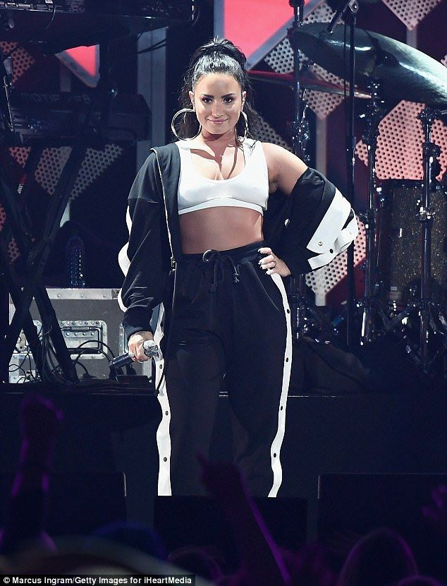 Demi Lovato bares her belly in bra-top for Jingle Ball | Daily Mail Online