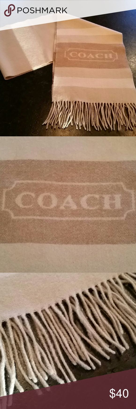 """Coach wool/cashmere striped scarf Coach wool (70%)/cashmere (30%) blend scarf in cream, tan and camel color stripes with large Coach logo.  Fringe detail. Excellent gently worn condition.  60"""" in length + fringe. Coach Accessories Scarves & Wraps"""