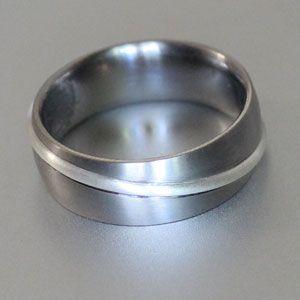 raised silver and titanium ring