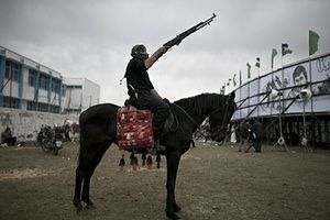 A Palestinian loyal to the Hamas movement sits on a horse
