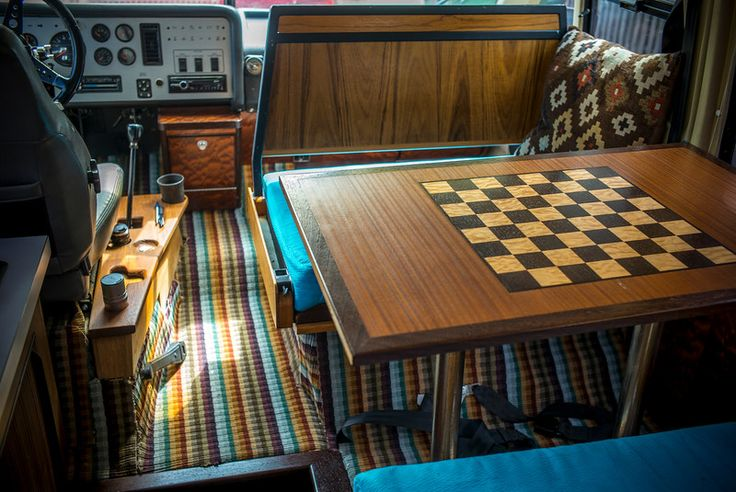 I've had much of the interior rebuilt, using fine woods (teak, sapele, and wenge) as well as fabrics and carpeting by Missoni Home. The front passenger seat back flips over to face forward while driving or backward to eat or play chess on the inlaid table. The teak side console has been carved out to accommodate my camera, lenses, pens, spare change, coffee cup, etc. The driver's seat is made by Ricaro. The 5 speed stick shift and powerful turbo allows for very sporty driving. While top…