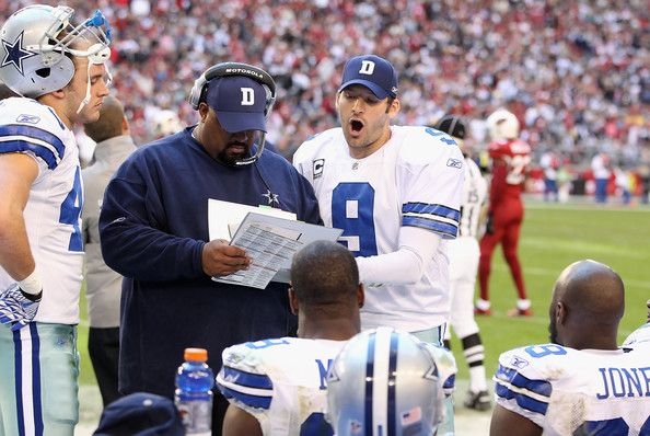 Tony Romo Photos Photos - Quarterback Tony Romo #9 of the Dallas Cowboys talks with runningback coach Skip Peete on the sidelines during the NFL game against the Arizona Cardinals at the University of Phoenix Stadium on December 4, 2011 in Glendale, Arizona. The Cardinals defeated the Cowboys 19-13 in overtime. - Dallas Cowboys v Arizona Cardinals