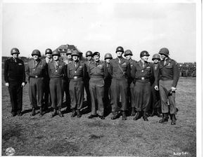 MUNCHEN-GLADBACH, GERMANY, BRITISH AWARD CEREMONIES. LEFT TO RIGHT, ARE: (1ST ROW) MAJ.GEN. McLAIN; MAJ.GEN. WILLIAM KEAN; LT.GEN. LEONARD GEROW; LT. GEN. COURTNEY HODGES; FIELD MARSHALL SIR BERNARD L. MONTGOMERY; LT. GEN WILLIAM SIMPSON; MAJ. GEN LAWTON COLLINS; MAJ. GEN JAMES GAVIN; (SECOND ROW) BRIG. GEN. RAYMOND MOSES; MAJ. GEN WALTER ROBERTSON; MAJ.GEN. RODERICK ALLEN; BRIG GEN HENRY NATCHETT; BRIG. GEN JOHN ROGERS, AND BRIG. GEN. WILLIAM HARRISON. 3/30/45