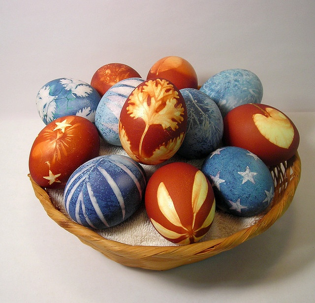 The red/rust colored eggs are dyed with yellow onion skins and the blue eggs are dyed with purple cabbage