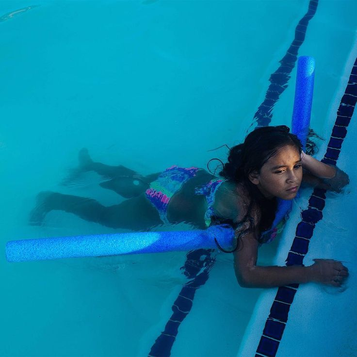 """Seven-year-old Layla, photographed by @saranaomiphoto at a pool near her grandmother's home in Texas, is a member of Troop 1500, which has been running its Girl Scouts Beyond Bars program in Austin since 2000. Once a month, the group travels almost two hours to the Gatesville Correctional Facility, where mothers and their daughters get to catch up, cuddle, eat lunch and play games. They're able to feel """"normal"""" for an afternoon in a space that resembles a classroom more than it does a…"""