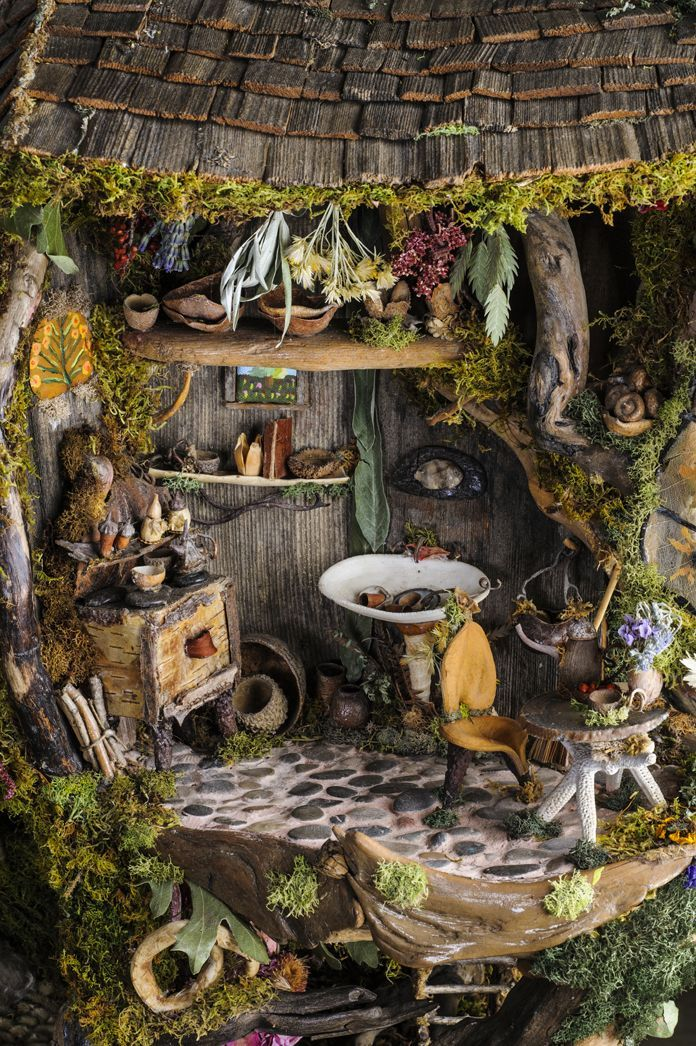 Charming Fairy Cottage - lots of great ideas here but what I really wanted to save was the idea for the floor - stones with a plaster/grout mix - such a wonderful idea! - 40 Magical DIY Fairy Garden Ideas