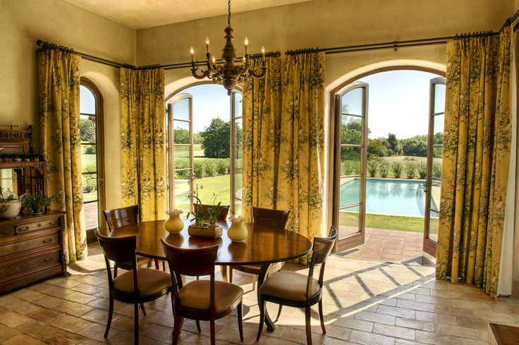 french door window treatments in Dining Room Mediterranean with curtains arched doorway