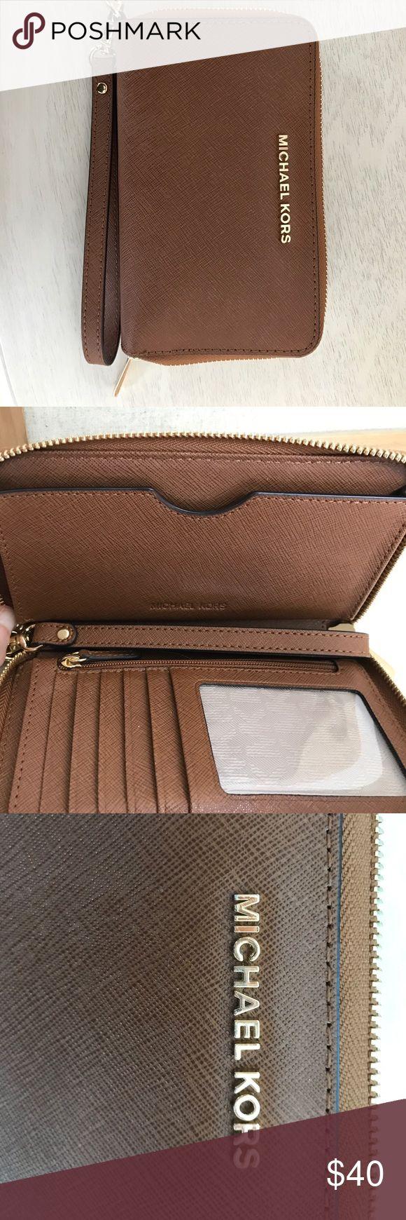Michael Kors Jet Set Wallet MK Jet Set Wallet in color luggage EXCELLENT Condition. Michael Kors Bags Wallets