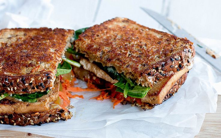 This sandwich is a must-make. Extra firm sprouted tofu is marinated in a simple mixture of vegetable broth, liquid smoke, soy sauce, and maple syrup.