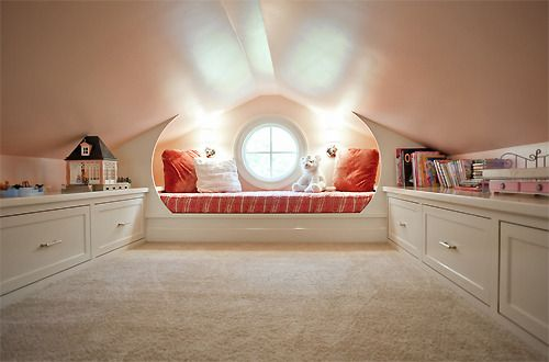 Animate your attic. Fun and bright idea of transforming a commonly unfinished space, into a child's play area. We love the round window detail in the dividing wall allowing natural light to flood the space. Keep the clutter to a minimum with shelf...