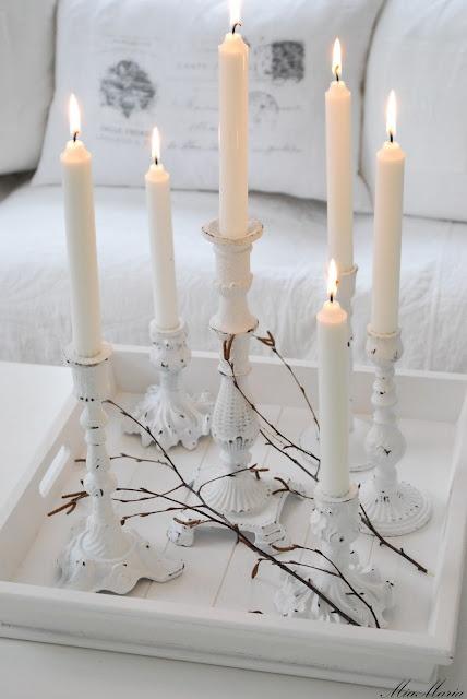 I love shabby chic white candle sticks :)