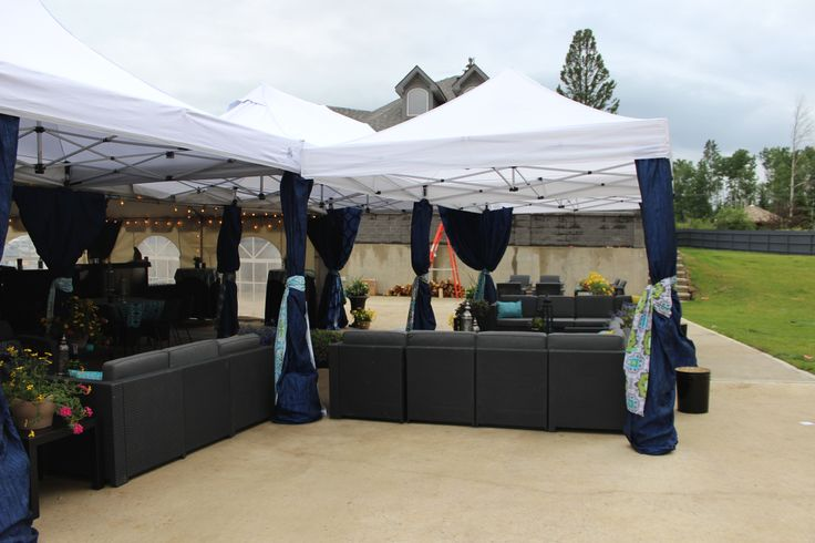 Adding panels of navy taffetta to the white tents was a great way to give them a unique look