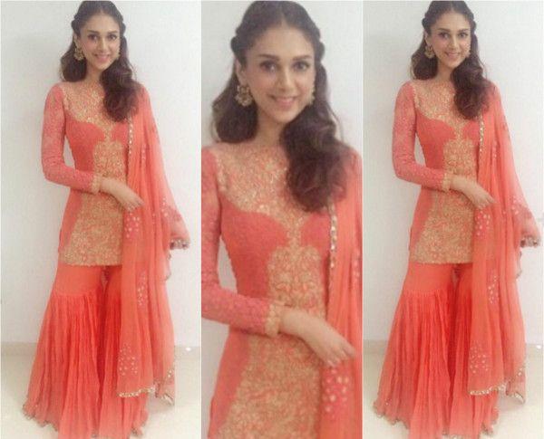 A pop orange outfit by Ridhi Mehra worn by Aditi Rao Hydari #AditiRaoHydari #RidhiMehra #GetTheLook #DesignerOutfitsOnline #Stage3