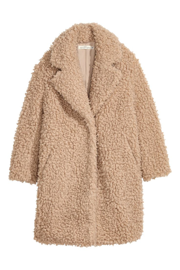 Light beige. Faux fur coat with large notched lapels, long sleeves, and concealed side pocket. Hook-and-eye fastening. Lined.